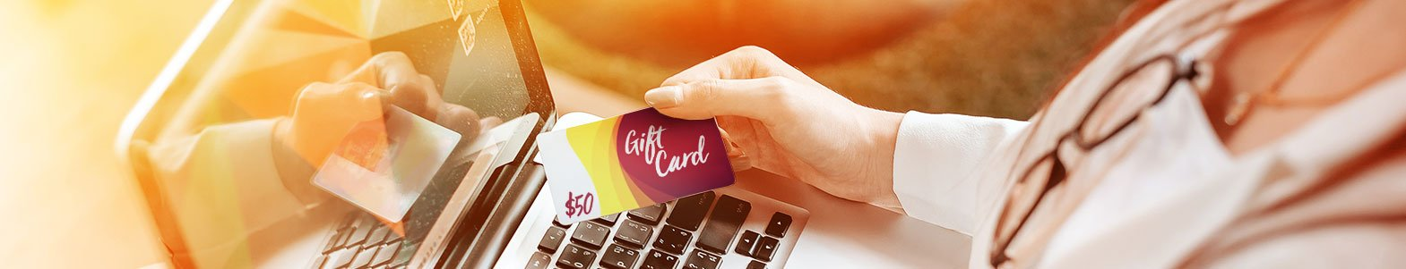 Anonymous-At-Computer-With-Gift-Card.jpg